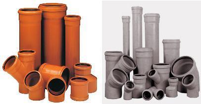 Наружные (оранжевые) и внутренние (серые) ПВХ трубы